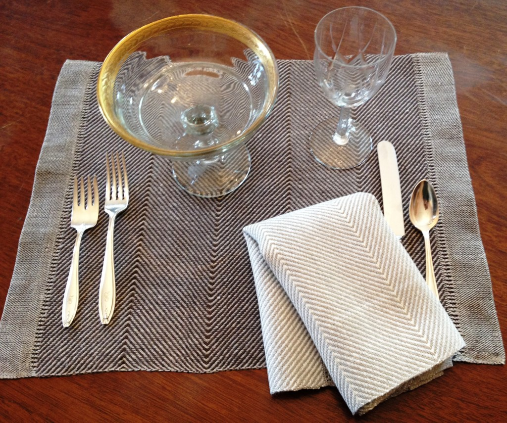 Placemat Article 476; two colorways:  brown or beige herringbone pattern.